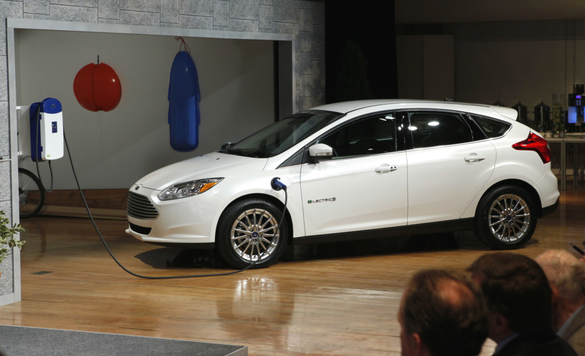 Ford Focus Electric is revealed for the first time in New York City, Friday, Jan. 7, 2011. The all new Ford Focus Electric is Ford's first all-electric passenger car and one of five new electrified vehicles Ford will deliver by 2012. (Photo/Stuart Ramson/Ford) (1/7/2011)