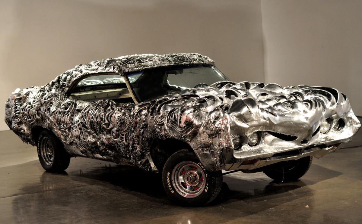 Винегрет из забавных автомобильных фактов - напечатанный из металла автомобиль