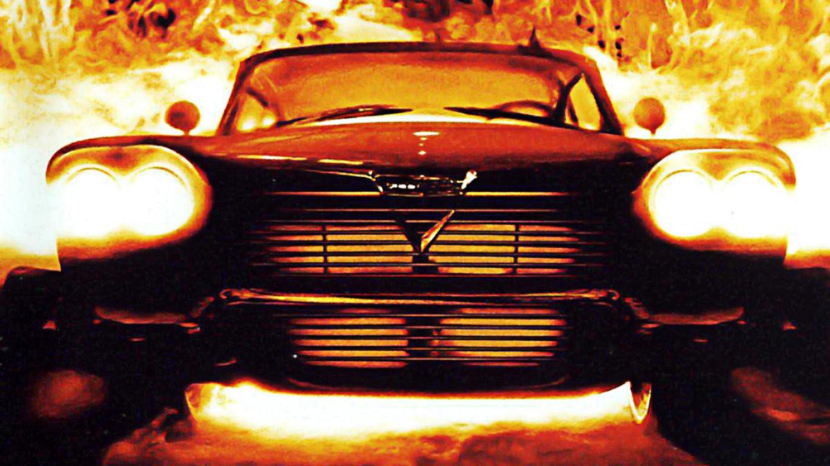 автомобиль с включенными фарами